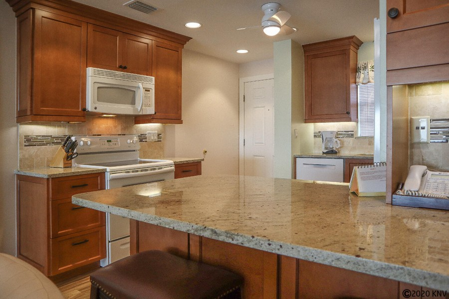 Beautiful kitchen with granite countertops and custom cabinets.
