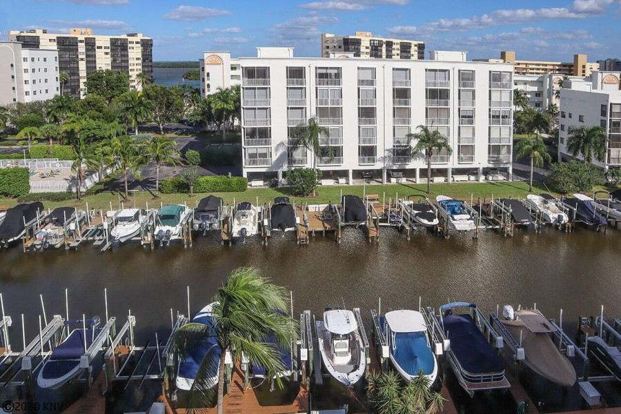Fabulous waterfront view of the wide canals at Hibiscus Pointe and Estero Bay beyond.