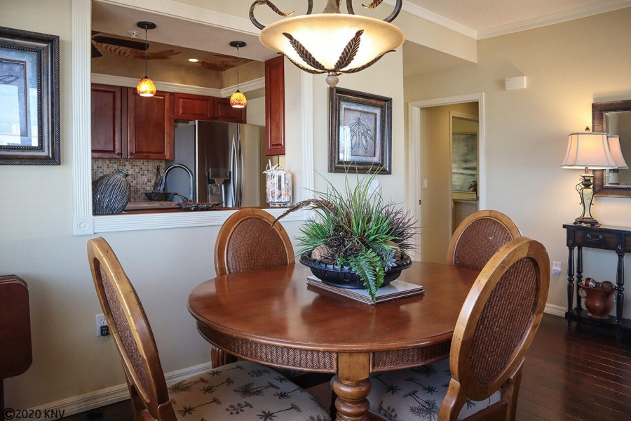 Formal dining table for four sits in the middle of the spacious open floor plan.