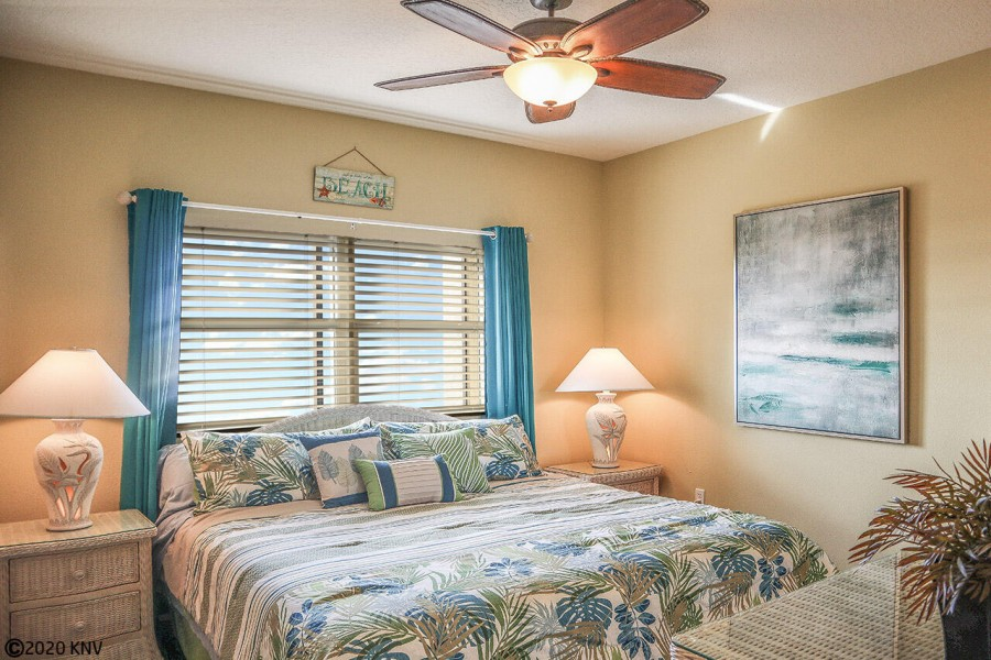 Lovely 1st Guest Bedroom has a Queen Sized Bed, ceiling fan and its own wall mounted TV