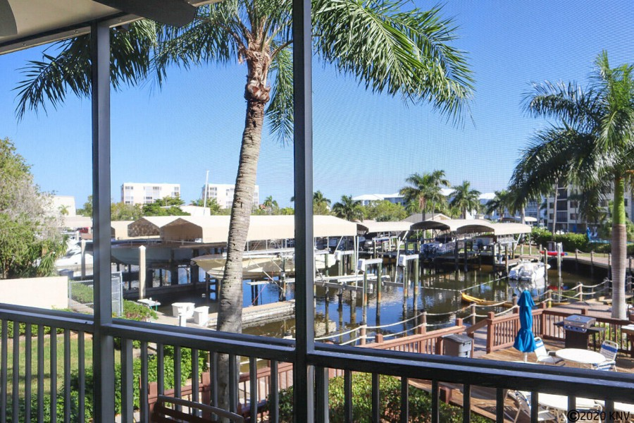 You can enjoy this waterfront view from your screened in lanai full of tropical beauty all day, ever