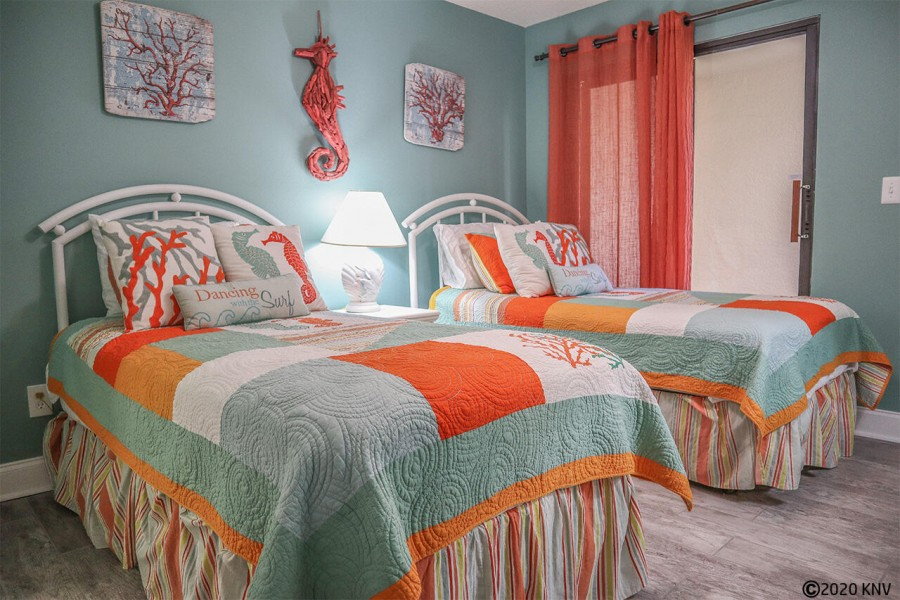 Guest Bedroom has two twin beds.