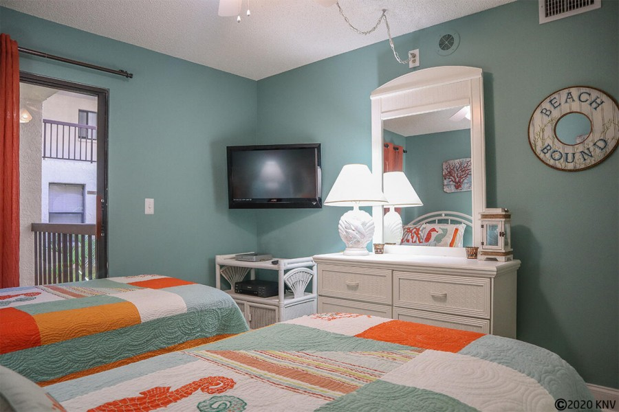 Like the Master Bedroom, the Guest Bedroom has a ceiling fan, lovely furnishings and its own TV
