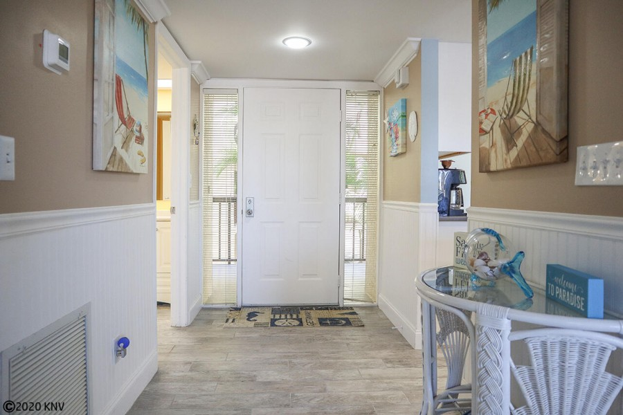 Professionally decorated, this beautiful 2 story condo welcomes you to Fort Myers Beach