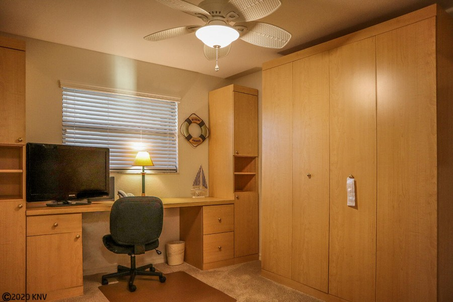 Guest Bedroom serves as an office with a pull down bed.