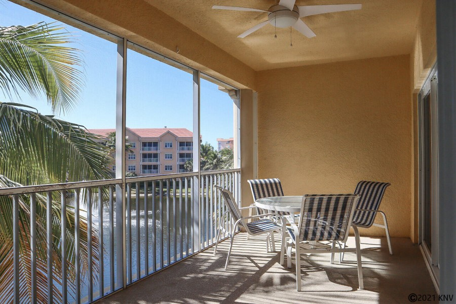 Overlooking the lake and tropical landscaping, the lanai offers a place for hours of relaxation