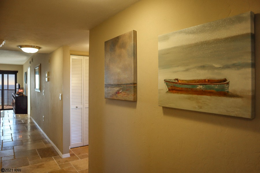 Beautiful Entry includes artwork, a mudroom and a view to the Gulf.