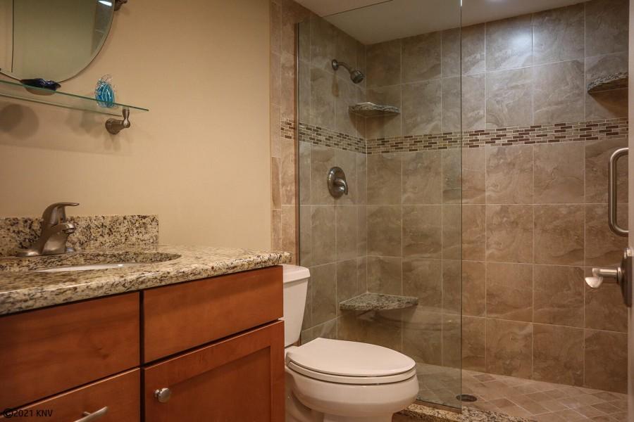 Guest Bath has a Walk In Shower