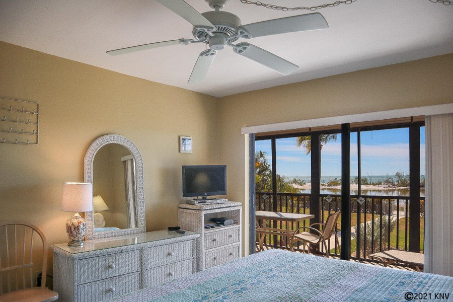 Master Bedroom has its own TV and private lanai access with a view