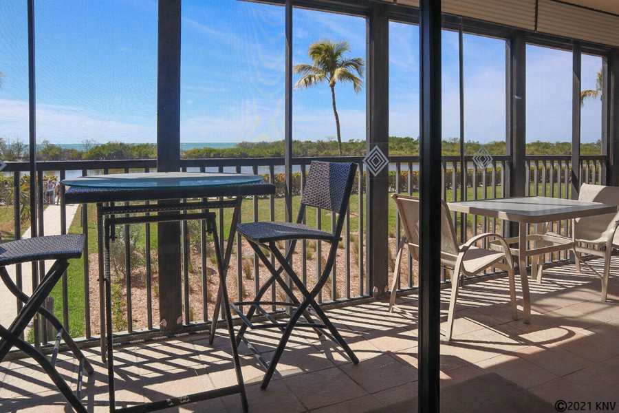 Huge screened in lanai with view of the Gulf