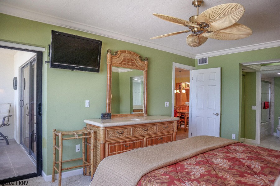 Master Bedroom has its own TV and private lanai access.