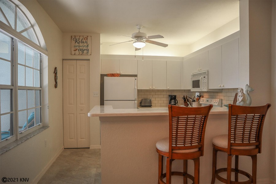 Large Fully Equipped Kitchen features a breakfast bar for two