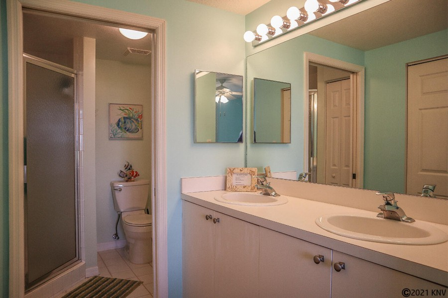 Master Bath has a Walk In Shower and double vanities