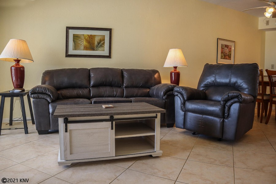Comfy seating and a large screen TV in the living area.