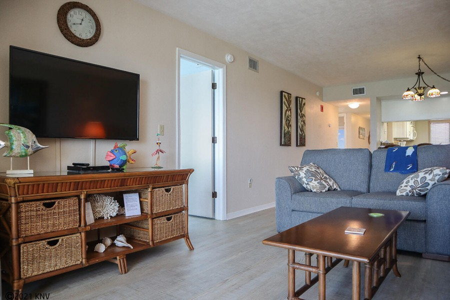 Large flat screen TV and comfortable seating in living area