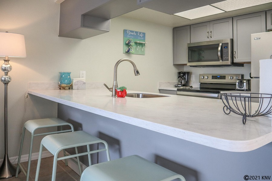 Kitchen has a breakfast bar for dining