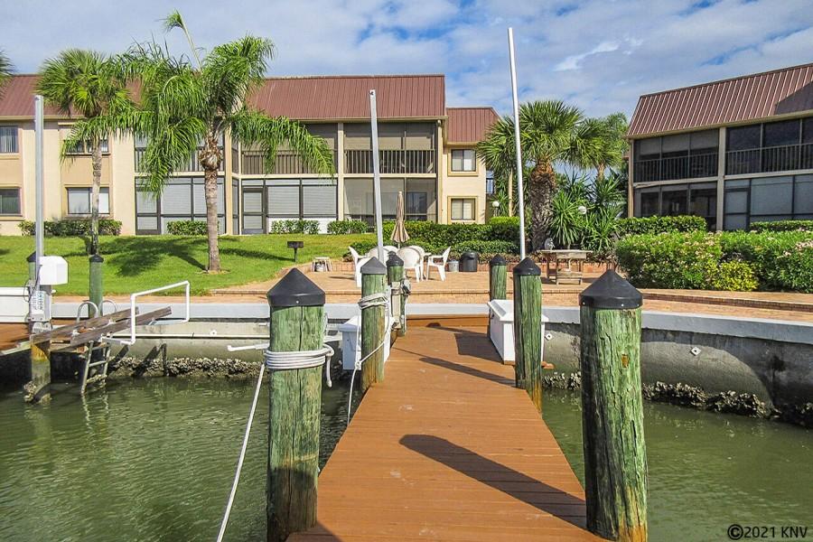 Boat docks line Estero Yacht and Racquet Club