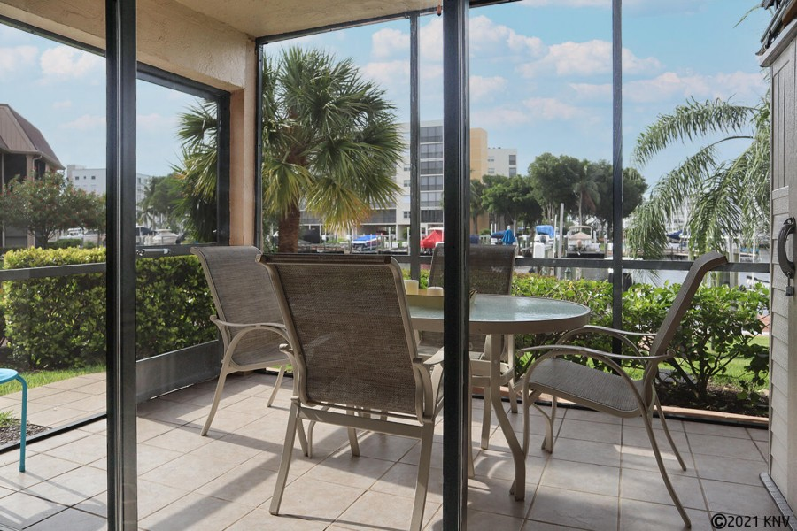 Screened In Lanai offers gorgeous view of the wide canal waterfront