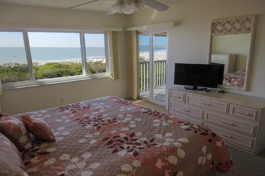 Sand Caper 705 Master Bedroom with private lanai access and flat screen TV