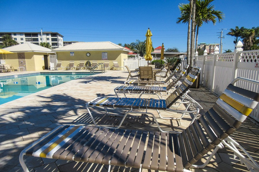 Relax by the Pool at Sand Caper Resort Condos