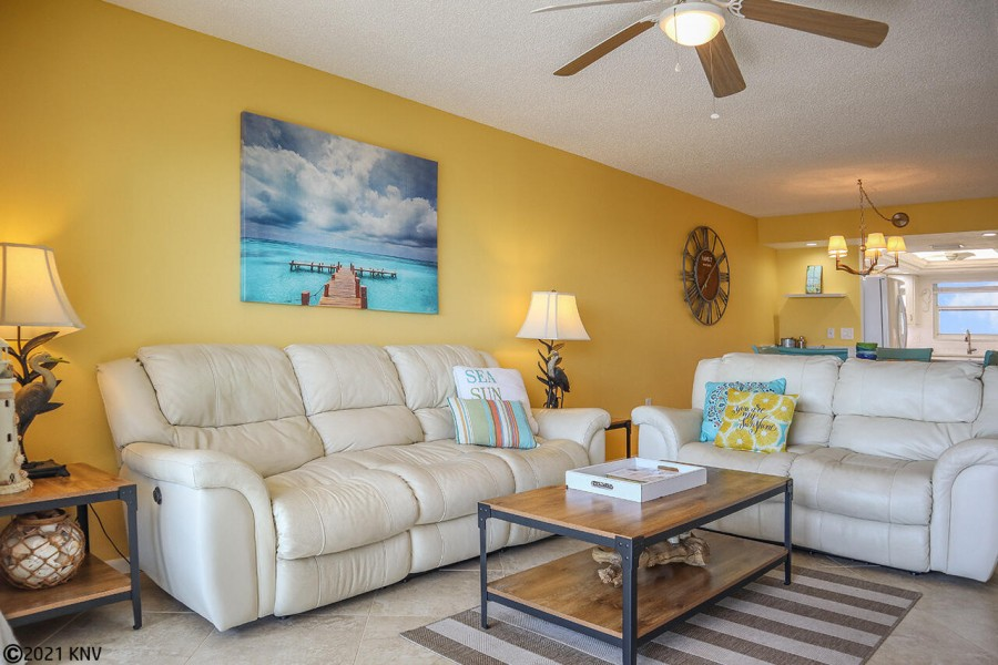 Comfortable reclining sofas, large screen TV, ceiling fan and lots of Florida flair