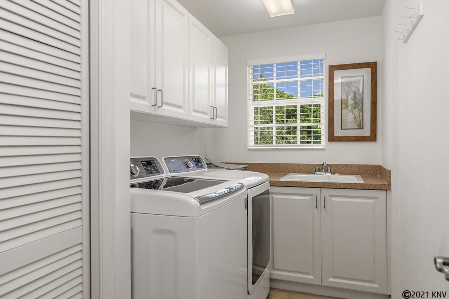 Laundry Room in the Condo has a full sized Washer and Dryer