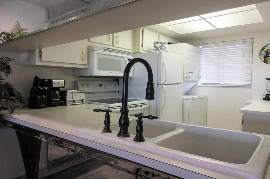 Fully Equipped Kitchen with in unit Washer and Dryer