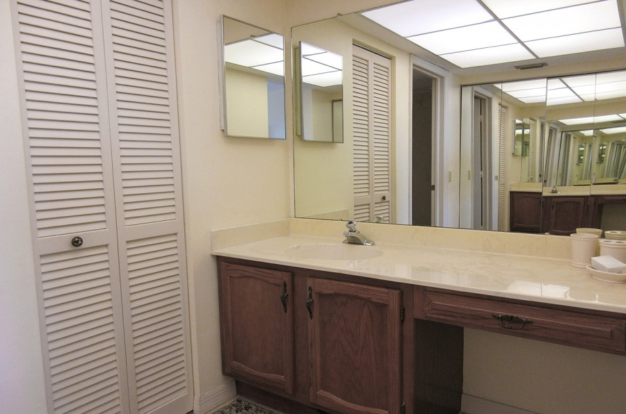 Master Bath with full height mirrored closet doors.