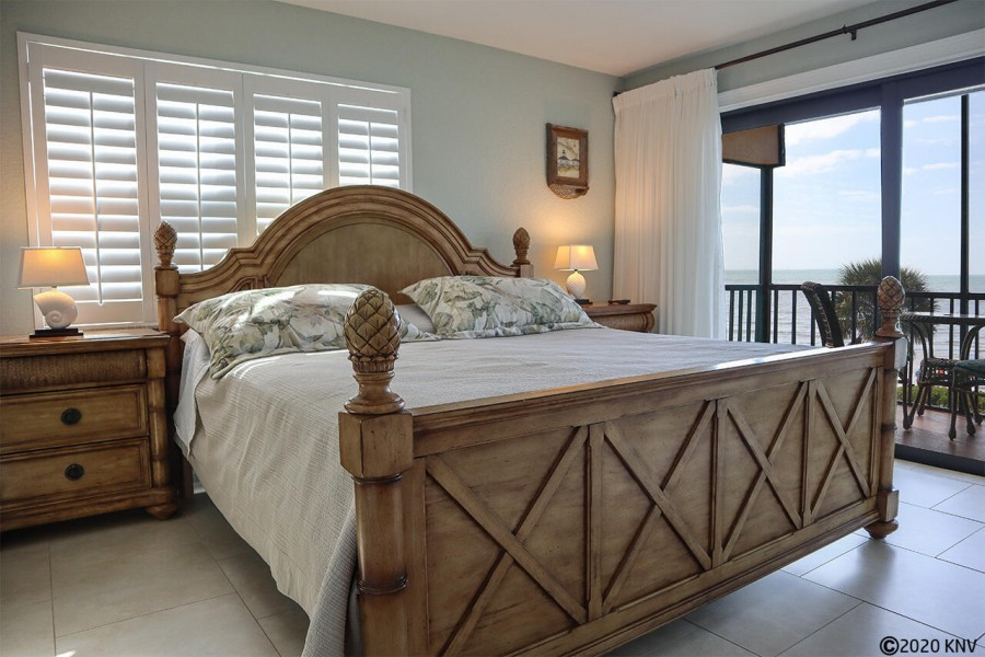King Sized Bed in the fabulous Master Bedroom with private lanai access