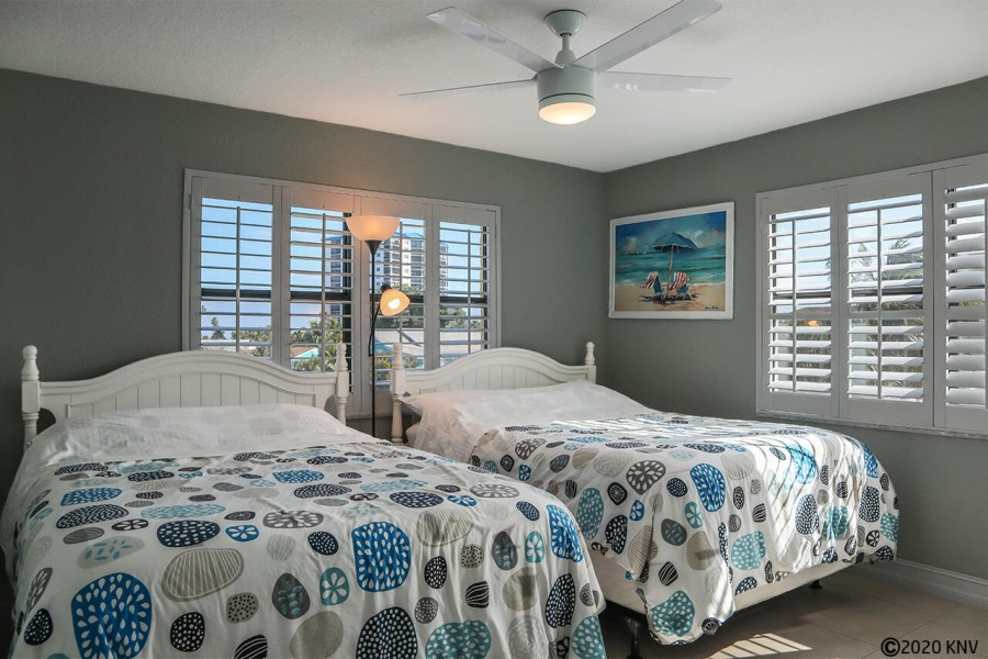 Two Comfy Double Beds in the Guest Bedroom