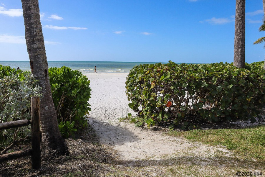 Steps to 7 miles of white sugar sand beach