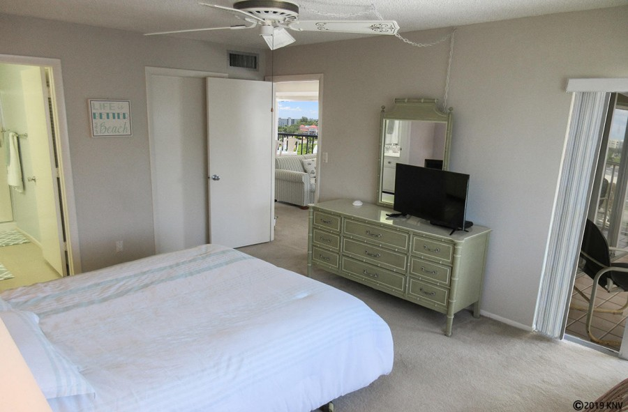 Master Bedroom has its own TV, private lanai access and en suite bath